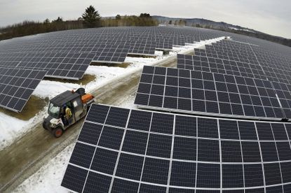 Solar panels stretch across 38 acres at the BNRG/Dirigo solar farm, Thursday, Jan. 14, 2021, in Oxford, Maine. One of the challenges of creating more renewable energy is not to destroy valuable forests and meadows while doing so. (AP Photo/Robert F. Bukaty)