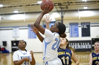 Western Tech's Destini Ward, shown shooting in a win over Perry Hall last month, had a team-high 20 points to lead the Wolverines to a 52-46 victory over Hereford on Feb. 12.