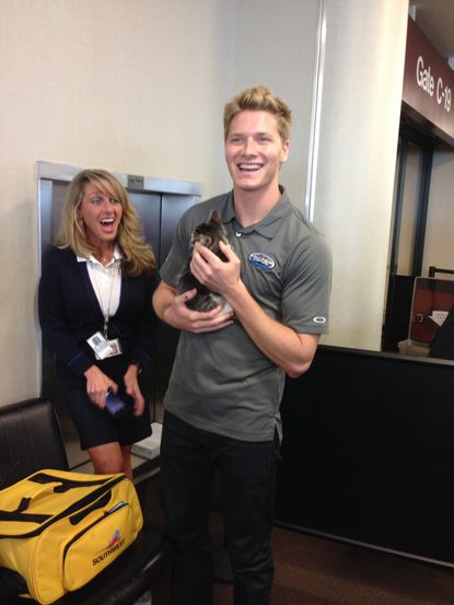 """MJ the kitten flew to Nashville today to be reunited with Josef Newgarden, the IndyCar driver who fell in love with him during the Grand Prix of Baltimore. Newgarden and the kitten posed together for a """"Show Your Soft Side"""" anti-animal abuse poster."""