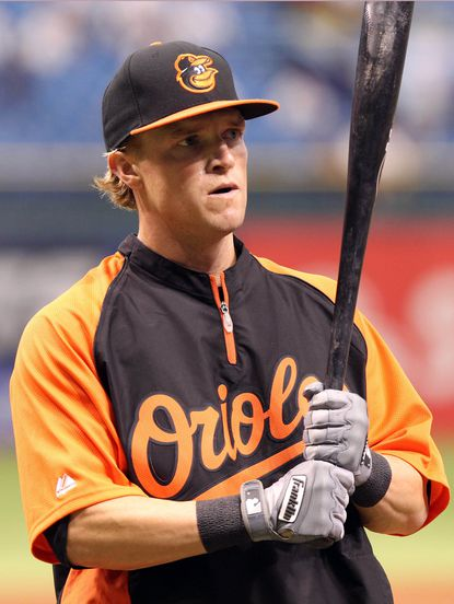 Outfielder Nate McLouth warms up before his first game with the Orioles on Saturday.