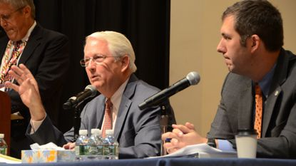 Republican Baltimore County executive candidate Al Redmer Jr., left, makes a point during a debate with Democratic candidate Johnny Olszewski Jr., right, on Thursday. The debate in Towson was hosted by several groups in the real estate and development industry.