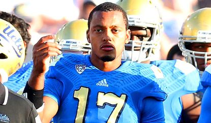 UCLA quarterback Brett Hundley watches from the sideline late in the game against Stanford on Nov. 28.