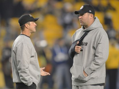 Ravens coach John Harbaugh chats with Steelers quarterback Ben Roethlisberger before the teams play last season. Roethlisberger missed the game due to an injury.