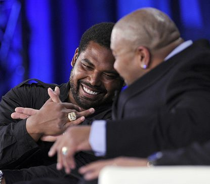 Retired Baltimore Ravens tackle Johathan Ogden shakes hands with retired Dallas Cowboys guard Larry Allen after they were inducted into the Pro Football Hall of Fame during a news conference at the Ernest N. Morial Convention Center in New Orleans, La. Saturday, Feb 2, 2013.