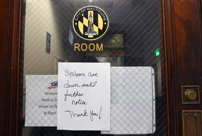 A posted sign on the door of the Baltimore Department of Public Work's water department office in the Abel Wolman Municipal Building because of a a ransomware attack on the city's computer system. (Kenneth K. Lam/Baltimore Sun).