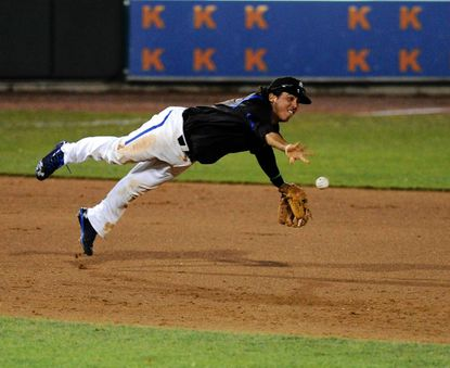 Aberdeen infielder Hector Veloz dives and flips the ball to his teammate at second hoping to make a double play after knocking down an infield hit during a game on Friday, July 5 game against Brooklyn.