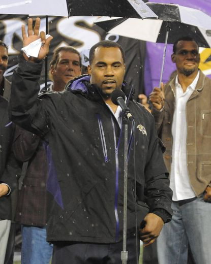 Former Ravens running back Jamal Lewis thanks the crowd at M&T Bank Stadium as he is inducted into the team's Ring of Honor at halftime of the game against the Browns.