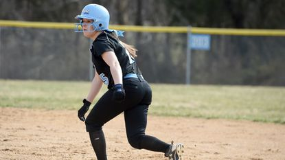 C. Milton Wright's Megan Marshall takes her lead from first base while watching her teammate at bat during Friday afternoon's home game against Perryville.