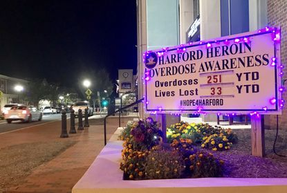 This sign bearing the current tally of Harford County's suspected drug overdoses, including fatalities, in front of the Sheriff's Office headquarters in downtown Bel Air is decorated with purple lights Tuesday night in honor of National Recovery Month, which Harford County is observing throughout September.