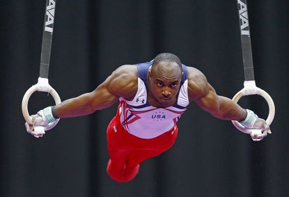 Donnell Whittenburg competes on the still rings during the AT&T American Cup.