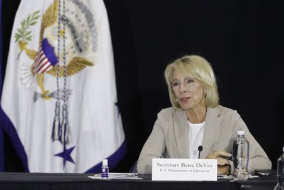 Education Secretary Betsy DeVos speaks during a meeting with higher education leaders on safely reopening schools last month in Indianapolis.