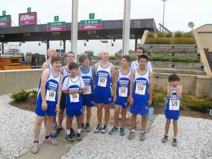 Special Olympics Howard County runners pose together at the Ft. McHenry Tunnel Run. Pictured are: Will Frisinger, Marcus Lesho, Mark Worley, Trip Logue, Jesse Carrico, Bruce Worly, Griffen Gundersen, Julian Than, Sam Carder and Jackson Cruz.
