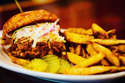 Jack Honey BBQ Pulled Pork Sandwich with fresh cole slaw and fries.