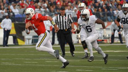 Maryland quarterback Perry Hills (11) sprints past Penn State Nittany Lions safety Malik Golden (6) for a first down during the third quarter in Baltimore.