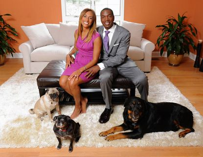 WBFF anchor Patrice Sanders (nee Harris) and her husband, celebrity trainer Monte Sanders, in their new home with their pugs, Seymour, left, and Bella, and their rottweiler, Konan.