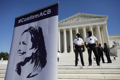 A poster with the nominee Judge Amy Coney Barrett is seen outside U.S. Supreme Court during the 2020 Women's March in Washington, D.C., on Saturday.