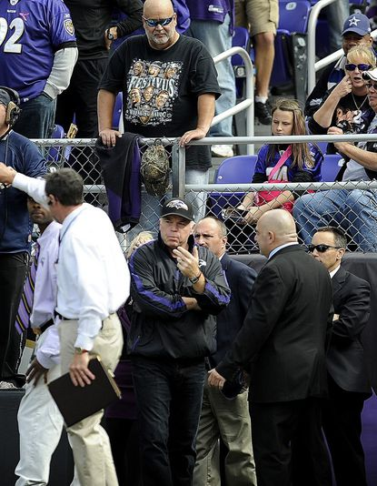 Orioles manager Buck Showalter walks off the field before the Ravens Oct. 14, 2012 win over the Cowboys.
