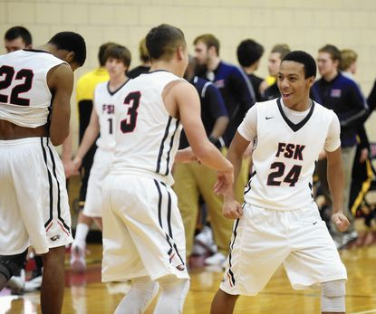Francis Scott Key's Rashad Giles, right, celebrates with teammate Jake Gosselin as time expires in the Eagle's 68-66 victory over South Carroll Friday, Dec. 11.