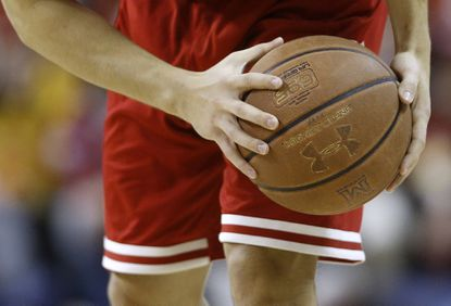Wisconsin guard Zak Showalter handles the Under Armour basketball in the first half of an NCAA college basketball game against Maryland, Saturday, Feb. 13, in College Park, Md.