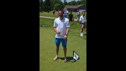 "Golfer Shawn Moxley won the putting contest at the May 25, 2018 Region IV Zone 3 Lions Golf Tournament held at Oakmont Green Golf Course in Hampstead. The contest prize was a ""split the pot,"" and Moxley won $90 for his successful putt."