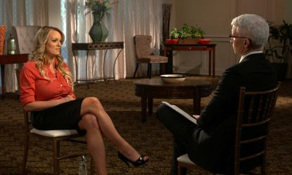 """This image released by CBS News shows Stormy Daniels, left, during an interview with Anderson Cooper which will air on March 25, 2018, on """"60 Minutes."""""""