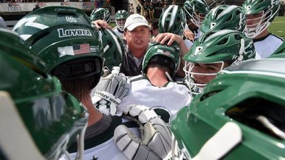 Loyola Maryland head coach Charley Toomey, center, gathers with his team after it defeated Army West Point to win the 2017 Patriot League men's lacrosse championship game at Ridley Athletic Complex.