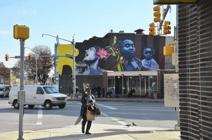 "Recent mural 'Sankofa' by Ernest Shaw Jr. is part of the ""Beautiful Walls For Baltimore"" tour"