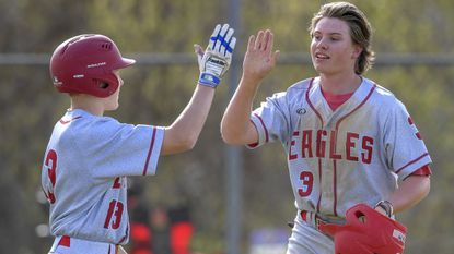 Centennial's Dylan Watson greets teammate Jack Pistner during a game against River Hill on April 10. The Eagles beat Reservoir, 4-0, in a 3A East region playoff game on May 11.
