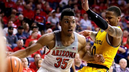 Arizona guard Allonzo Trier drives in the first half against UMBC's Jairus Lyles on Sunday, Nov. 12, 2017, in Tucson, Ariz.