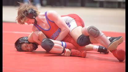 Lansdowne's Riley Bozeman, top, battles with Wootton's Eric Liau during the finals in the 4A/3A 106 weight class at the state championships. Bozeman, a sophomore, lost the match and finished second.