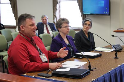 From left, Carroll County Health Officer Ed Singer, Emergency Management Manager Valerie Hawkins, and health planner Maggie Kunz discuss plans to prepare for COVID-19 at the Board of County Commissioners meeting Thursday.