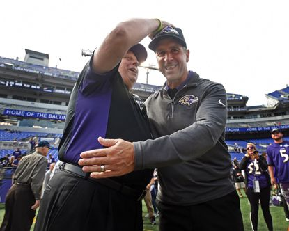 "Maryland Gov. Larry Hogan, left, gives a ""blessing"" to Ravens head coach John Harbaugh, right, for a Ravens win against the Bengals at M&T Bank Stadium."