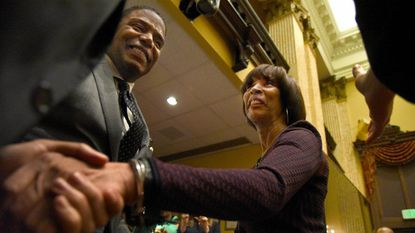 Mayor Catherine Pugh is greeted by Calvin G. Butler Jr., CEO of BGE, and other well-wishers after delivering the State of the City Address in City Council chambers.