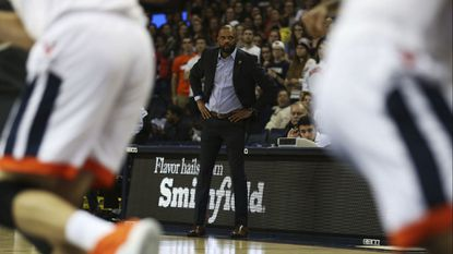 Coppin State coach Juan Dixon watches his team play Virginia during the first half of an NCAA college basketball game Friday, Nov. 16, 2018, in Charlottesville, Va.