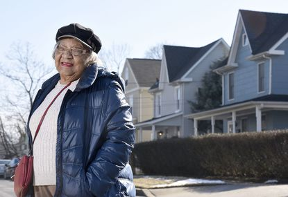 Adelaide Bentley, former president of the North East Towson Improvement Association, stands on Lennox Avenue. She passed away last week at the age of 91.
