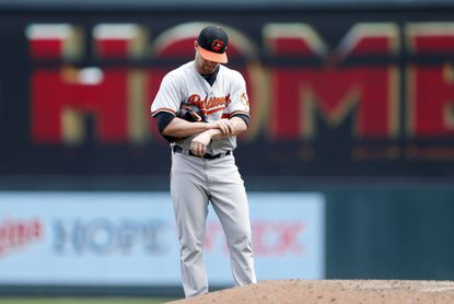 Orioles pitcher Bud Norris gives up a two-run home run to the Minnesota Twins' Brian Dozier in the sixth inning, Wednesday, July 8, 2015, in Minneapolis. The Twins' Joe Mauer followed with a solo home run off Norris.