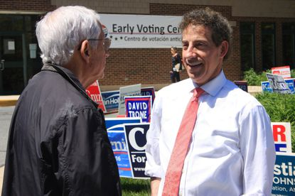 State Sen. Jamie Raskin, right, who is running for Maryland's 8th Congressional District, talks to a supporter who voted early for him, in Chevy Chase.