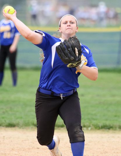 Liberty's Brooke Fowlkes throws to first for an out in county softball action at Westminster on Monday.