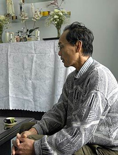 """Quy Trinh, 58, at home in Silver Spring, says of his daughter: """"She wanted to save people's lives."""""""