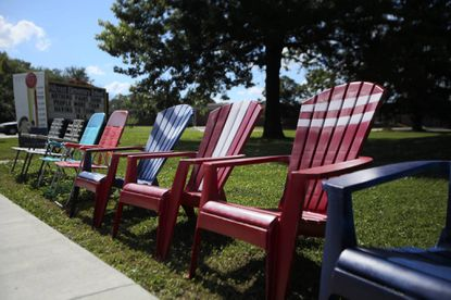 A variety of chairs are used by fans of the Catonsville Fourth of July Parade to reserve their spots on Frederick Road near Hillcrest Elementary School for Thursday's holiday event.