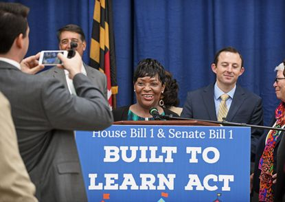 Maryland House Speaker Adrienne A. Jones has her picture taken at the podium before a news conference to make an education announcement relating to the new Kirwan Commission report on November 6 at Forest Heights Elementary School. Senate President Bill Ferguson, right, and other Democratic party leaders also attended.