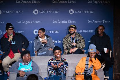 """Sherman Payne, back left, Caleeb Pinkett, Angel Manuel Soto, Clarence Hammond, Kezii Curtis, front left, Jahi Di'Allo Winston and Donielle T. Hansley Jr., laugh during a panel for """"Charm City Kings"""" at Los Angeles Times Live during the Sundance Film Festival presented by Chase Sapphire, Tuesday, Jan. 28, 2020, in Park City, Utah. (Photo by Jack Dempsey/Invision for Chase Sapphire/AP Images)"""