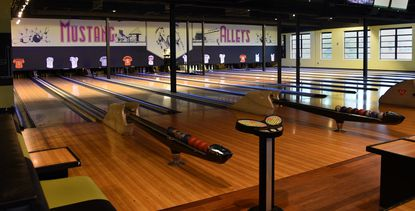 Mustang Alley's, the bowling alley/restaurant/bar near Little Italy, has reopened under new ownership.