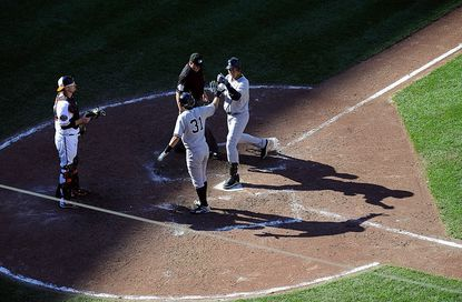New York Yankees designated hitter Derek Jeter celebrates at home plate with Ichiro Suzuki after Jeter hit a two-run home run in the top of the eighth inning of their 13-3 win in Baltimore Sunday.
