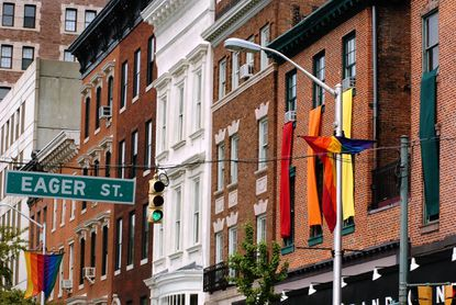 Mount Vernon businesses such as Grand Central fly the colors of the rainbow to show gay pride.