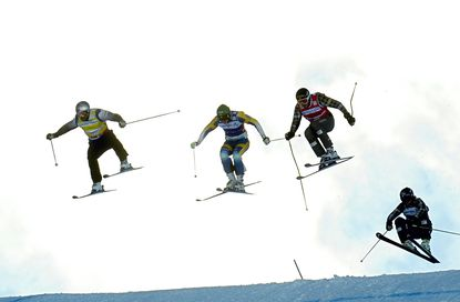 John Teller (left) and other competitors at the FIS men's Skicross World Cup final. (Phillipe Desmazes/Getty Photo)