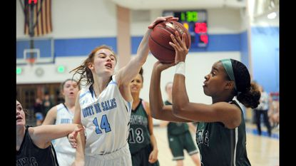 Megan Matsko, left, of Mount de Sales, blocked this shot by Glenelg Country School's Kennedy Williamson in a playoff win last season. Matsko, who will play at Carnegie Mellon next year, is one of the Sailors captains along with Anya Walker.