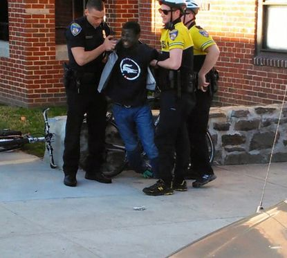 Freddie Gray is seen being taken into custody by Baltimore Police on April 12 in this still from a cell phone video.