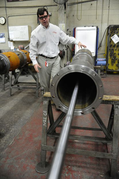 Chris Heacock, general manager of Flowserve in Taneytown, explains how the company builds the water pumps used to make snow for the Winter Olympics Monday.