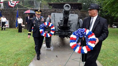 Brig. Gen. Sean M. Casey, Director of the Joint Staff of the Maryland National Guard, and state Sen. Johnny Ray Salling, Republican, District 6, are among those laying wreaths during the Defenders' Day at North Point dedication of restored WWI cannons at Fort Howard Park.